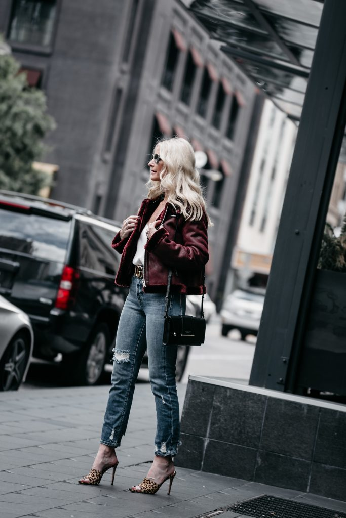 Dallas fashion blogger wearing leopard heels and shearling moto jacket