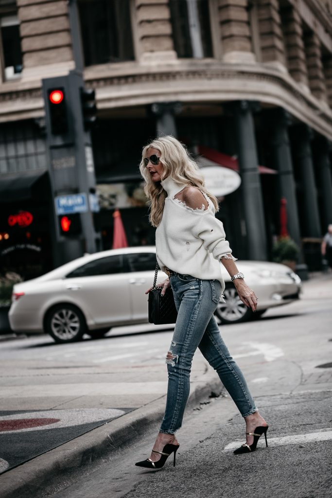 Dallas blonde woman wearing ripped jeans and Malone Soulier heels