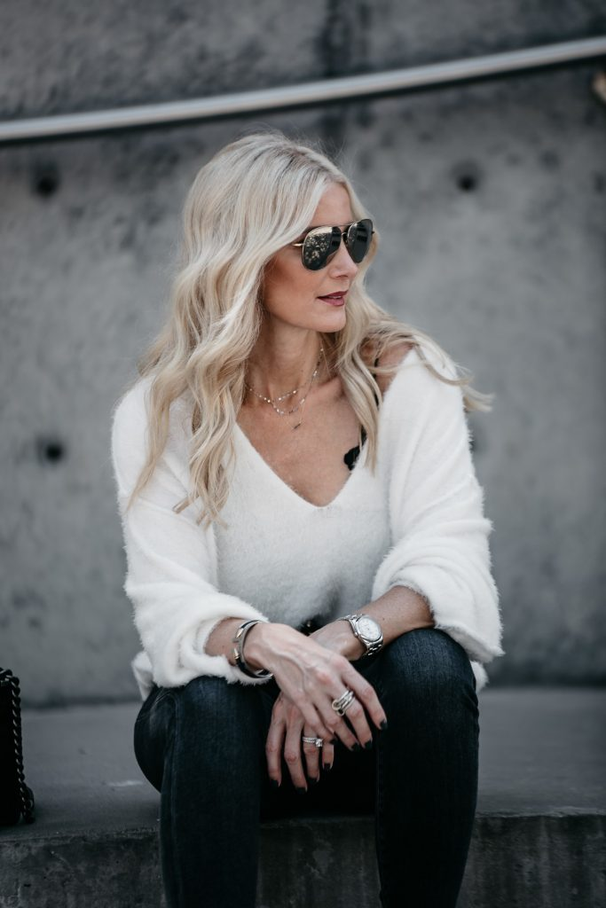 Dallas blonde girl wearing Free People sweater and gray jeans