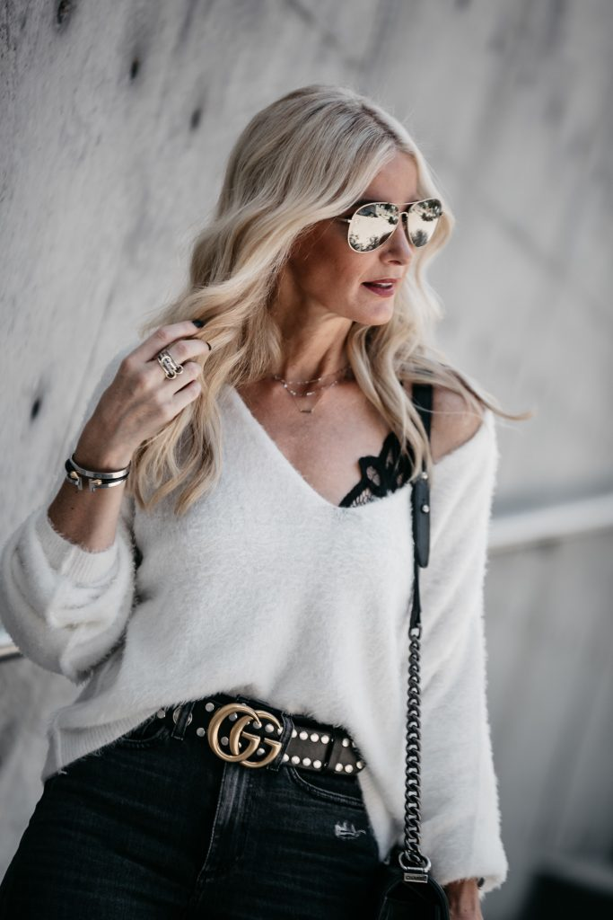 Free People sweater, Gucci Belt, and black lace bra