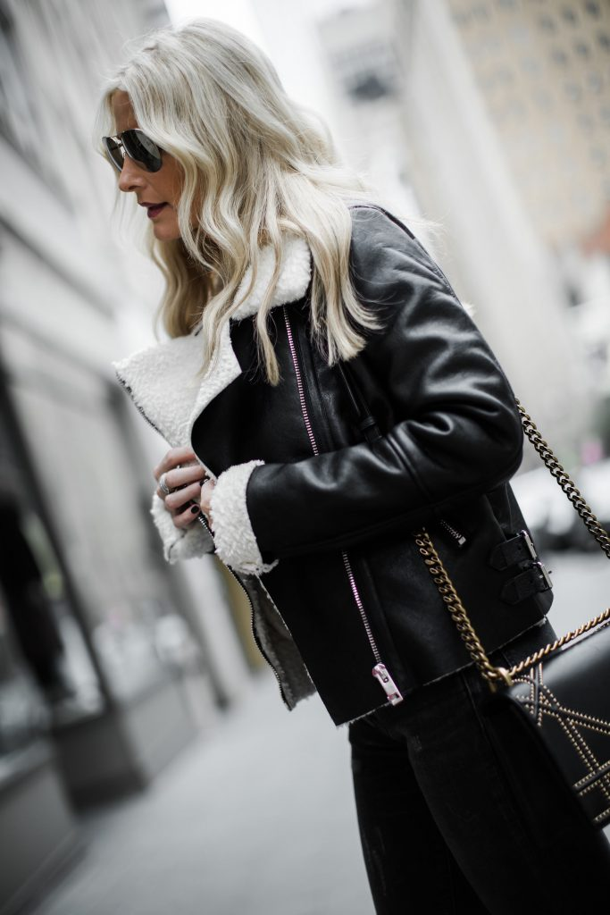 Dallas blogger wearing shearling moto jacket and leopard boots