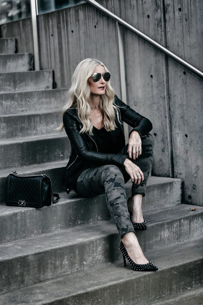 Dallas blogger wearing camo pants and leather jacket