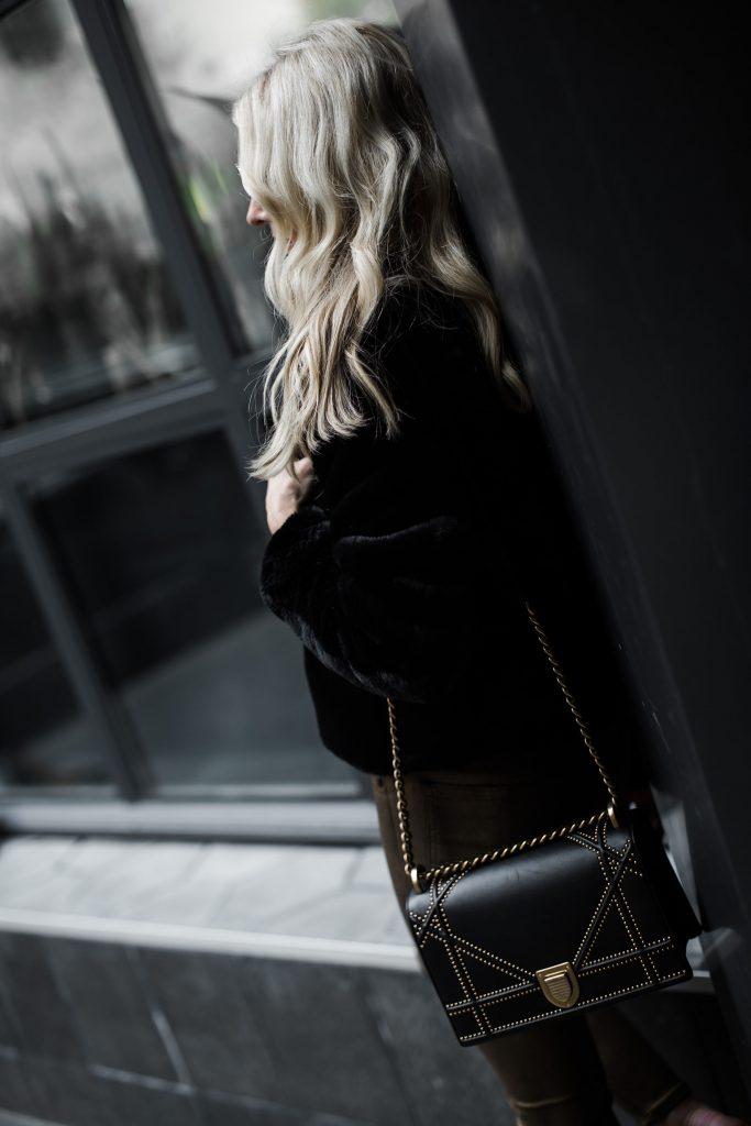 Dallas blogger wearing faux fur jacket and Dior Handbag