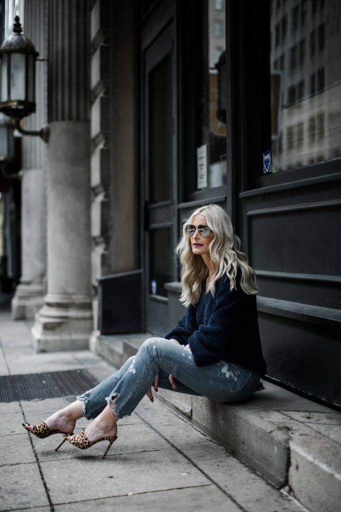 Dallas blonde woman wearing 3x1 denim and leopard jeans