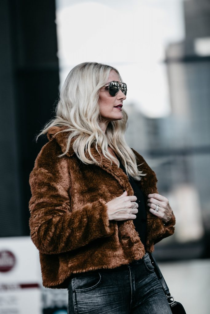Dallas blogger wearing Free People faux fur jacket