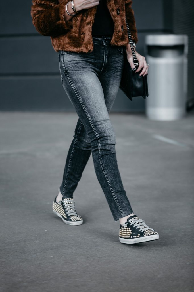 Dallas fashion blogger wearing faux fur jacket, Hudson gray skinny jeans, and Golden Goose Sneakers