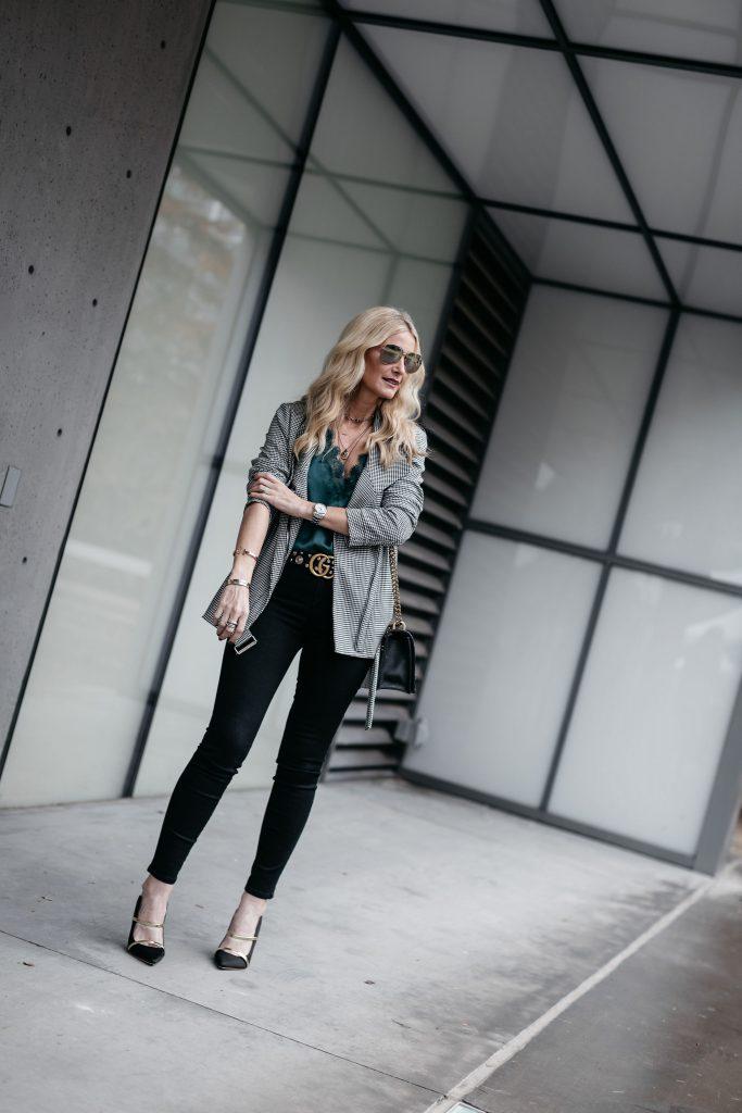 Dallas style blogger wearing black skinny jeans and Karen Kane moto jacket