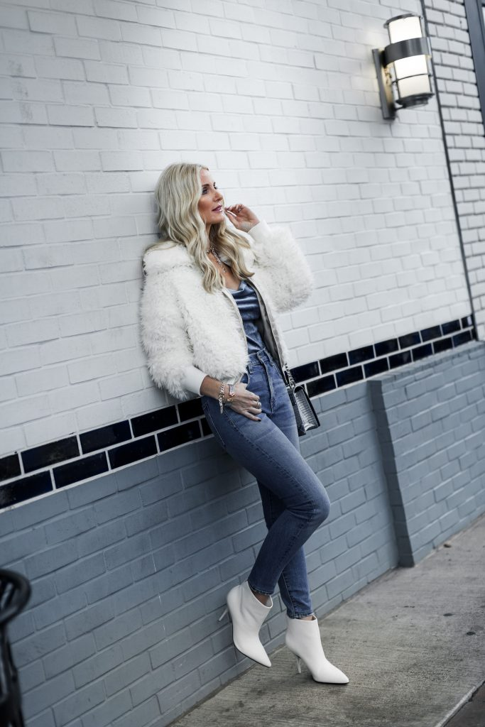 Dallas style blogger wearing Reformation faux fur jacket