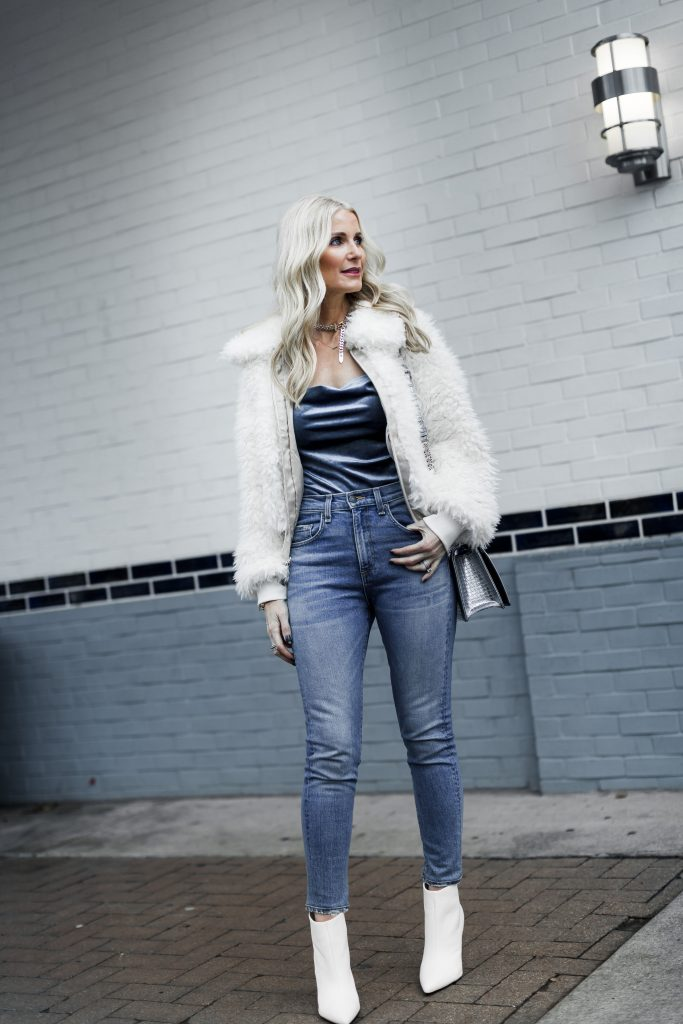Reformation faux fur jacket, Veronica Beard jeans, and Marc Fisher white booties