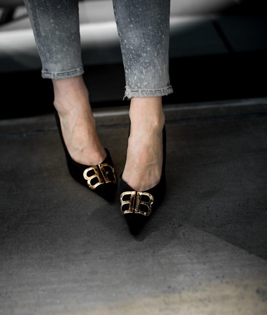 Balenciaga heels and gray skinny jeans