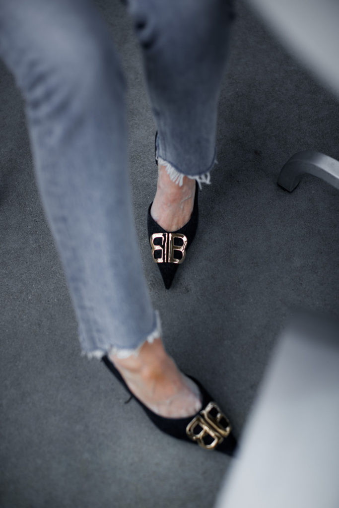 Dallas blogger wearing Balenciaga heels and Agolde jeans