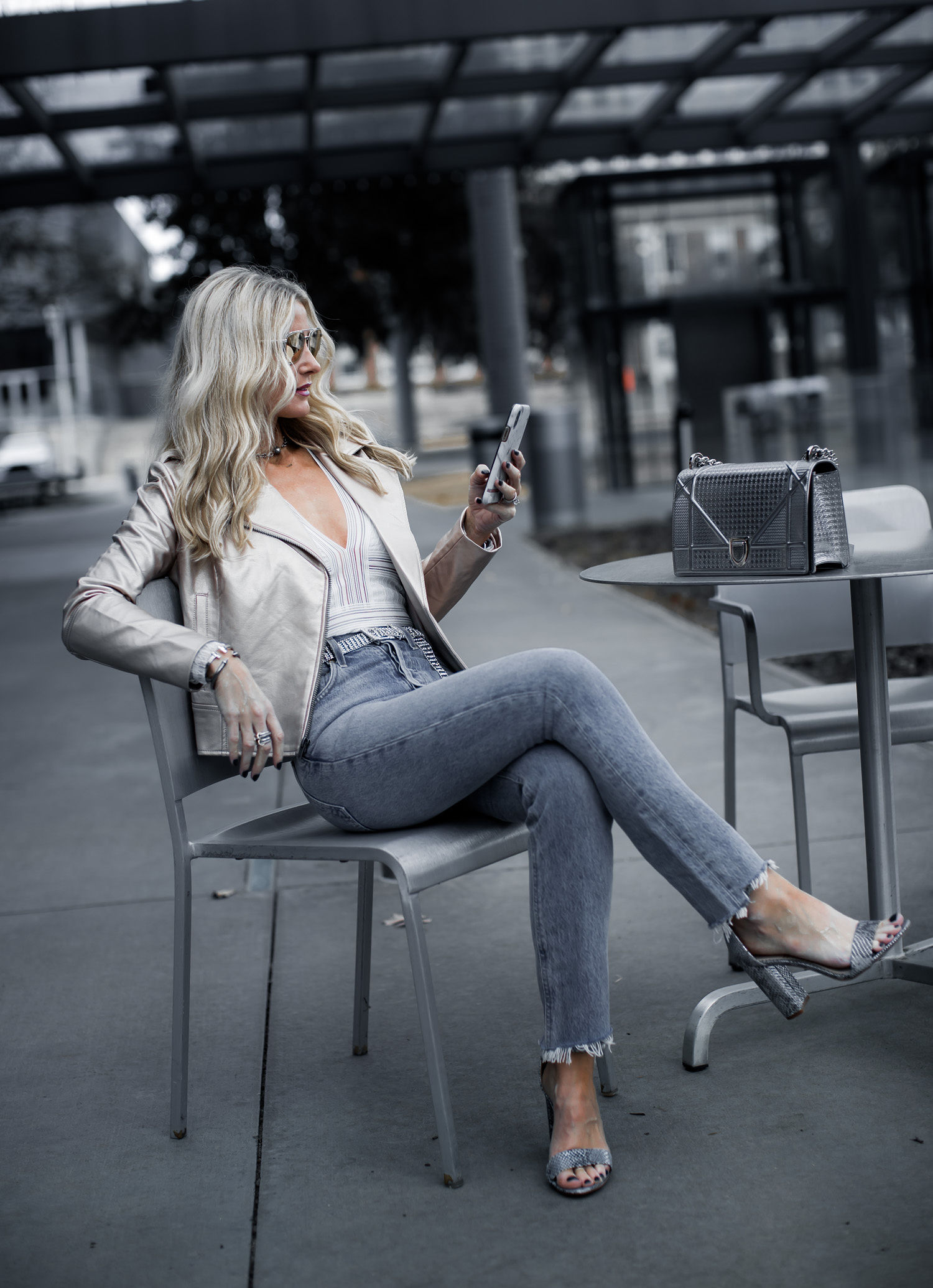 Dallas blogger weairng metallic moto jacket and Agolde jeans