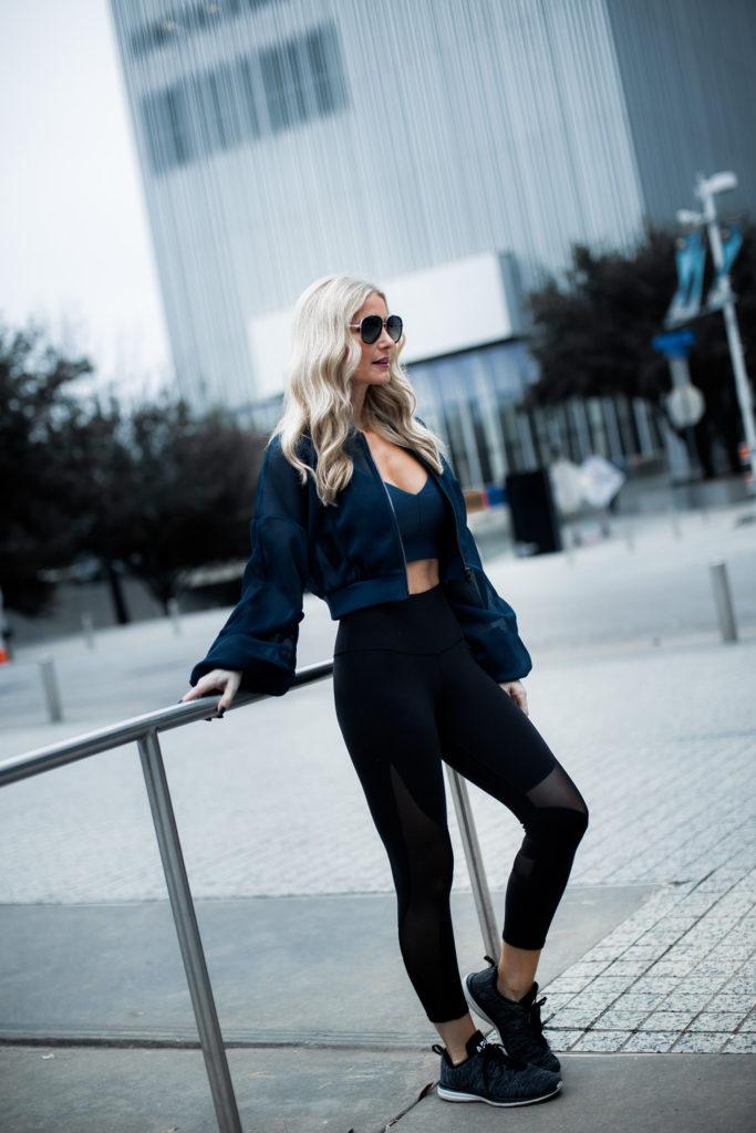 Dallas fashion blogger wearing Alo yoga jacket and leggings