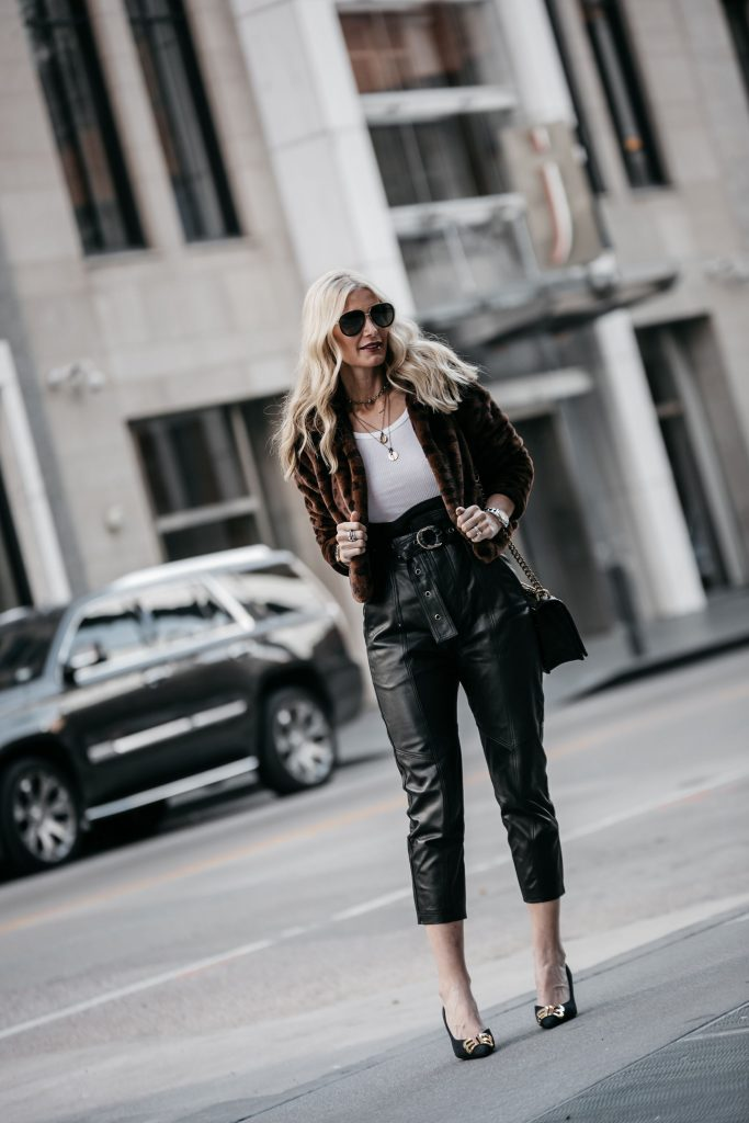 Dallas blogger wearing leather pants and teddy coat