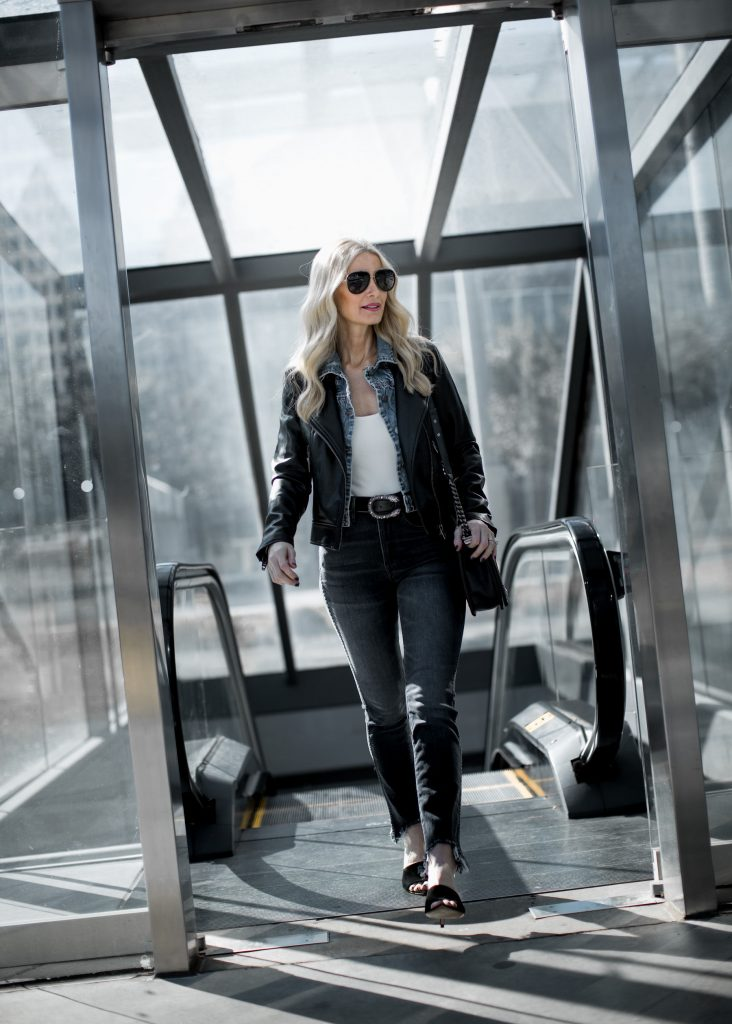 Dallas blonde woman wearing gray jeans and Gucci belt
