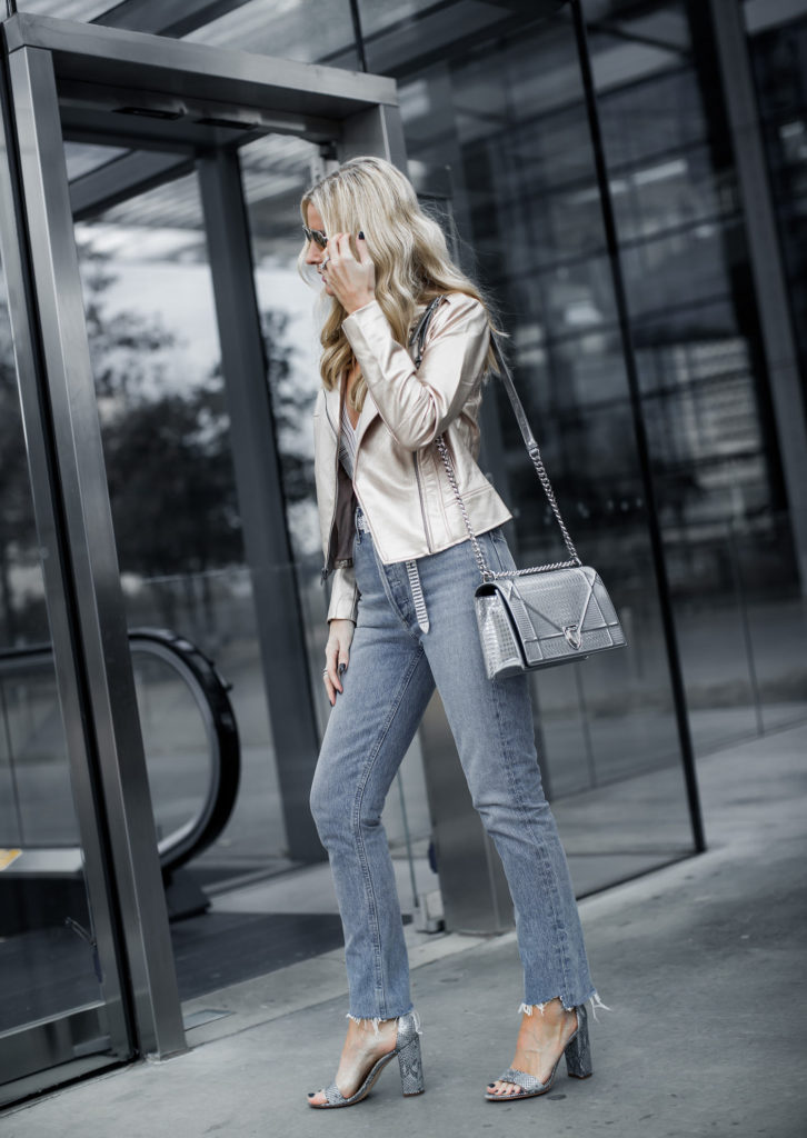 Dallas blogger wearing Agolde jeans and moto jacket