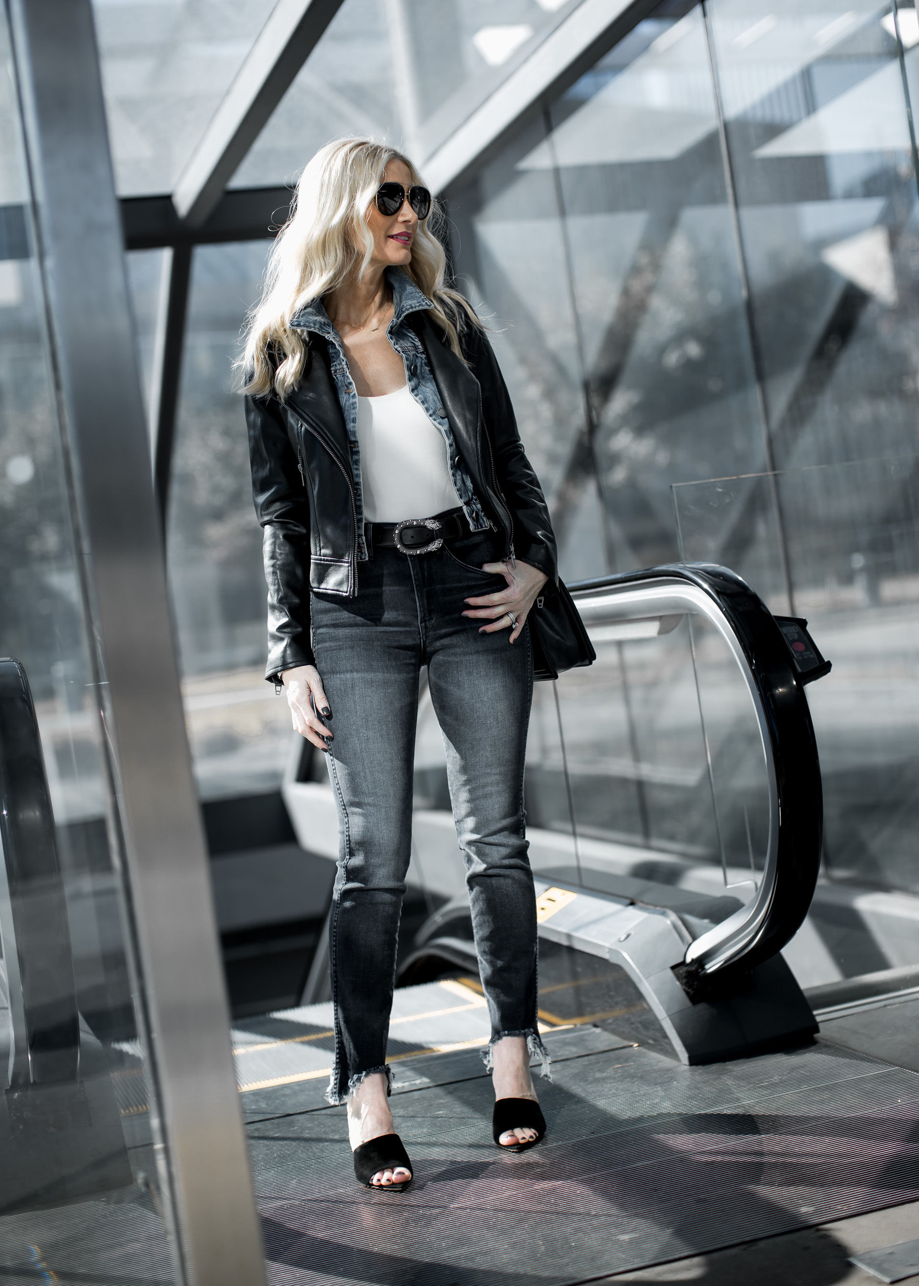 Dallas blogger wearing gray jeans, black leather jacket and Gucci belt