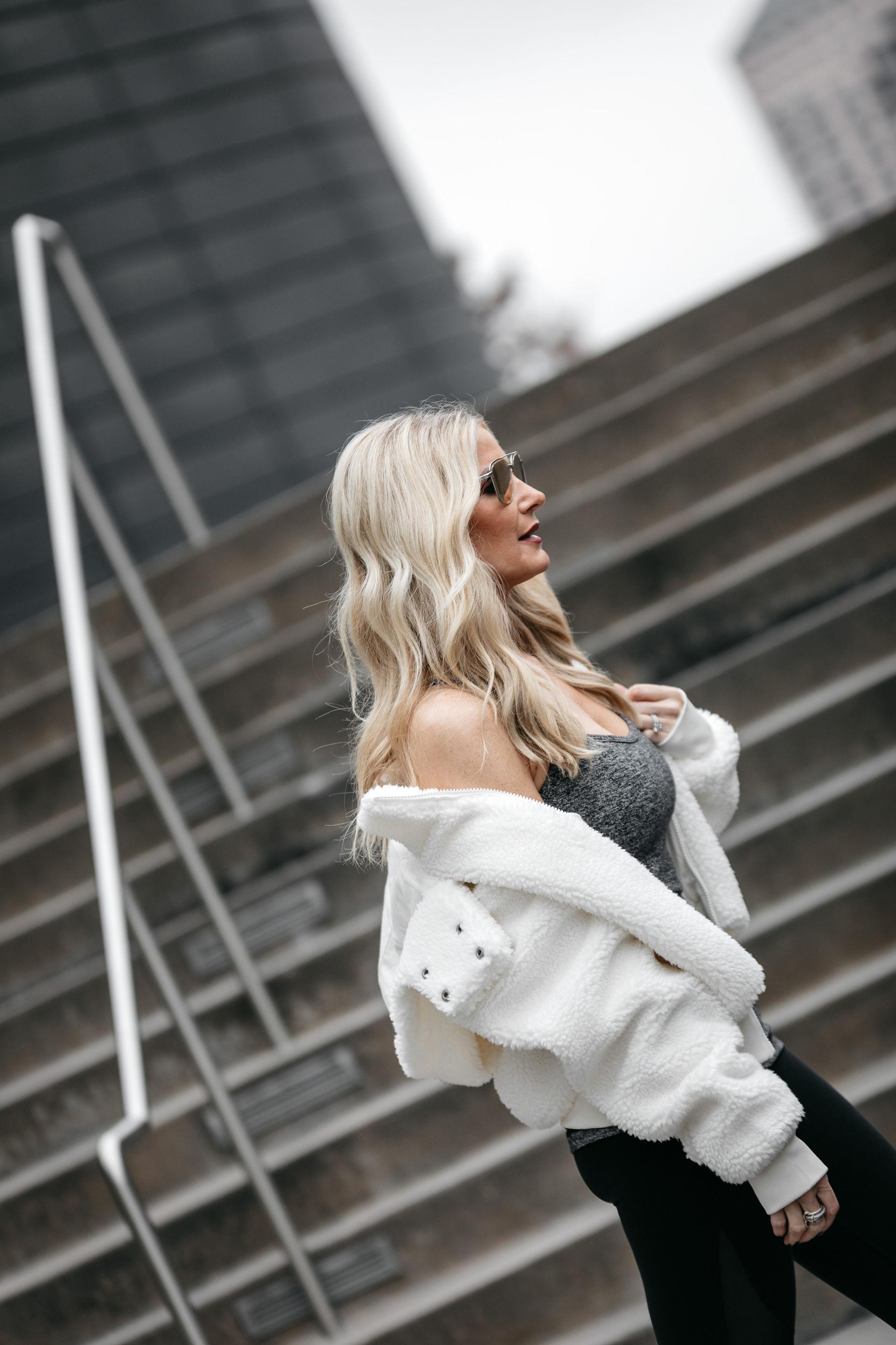 Dallas fashion blogger wearing Alo yoga teddy coat