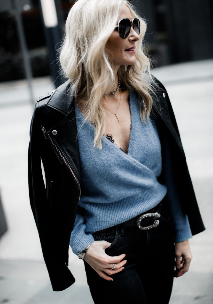 Dallas fashion blogger wearing a Something Navy wrap sweater