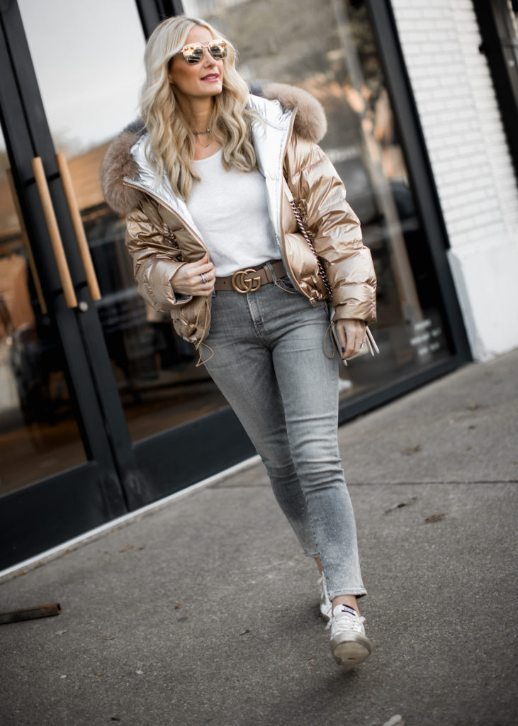 Dallas fashion blogger wearing puffer jacket, Golden Goose sneakers, and Gucci belt