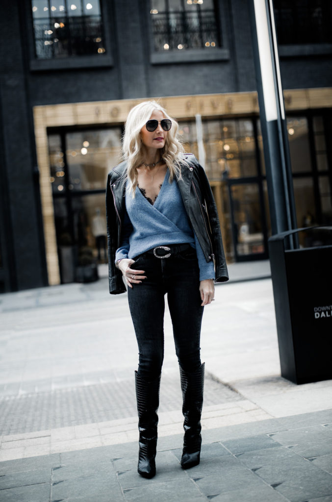 Dallas style blogger wearing knee high boots and black skinny jeans