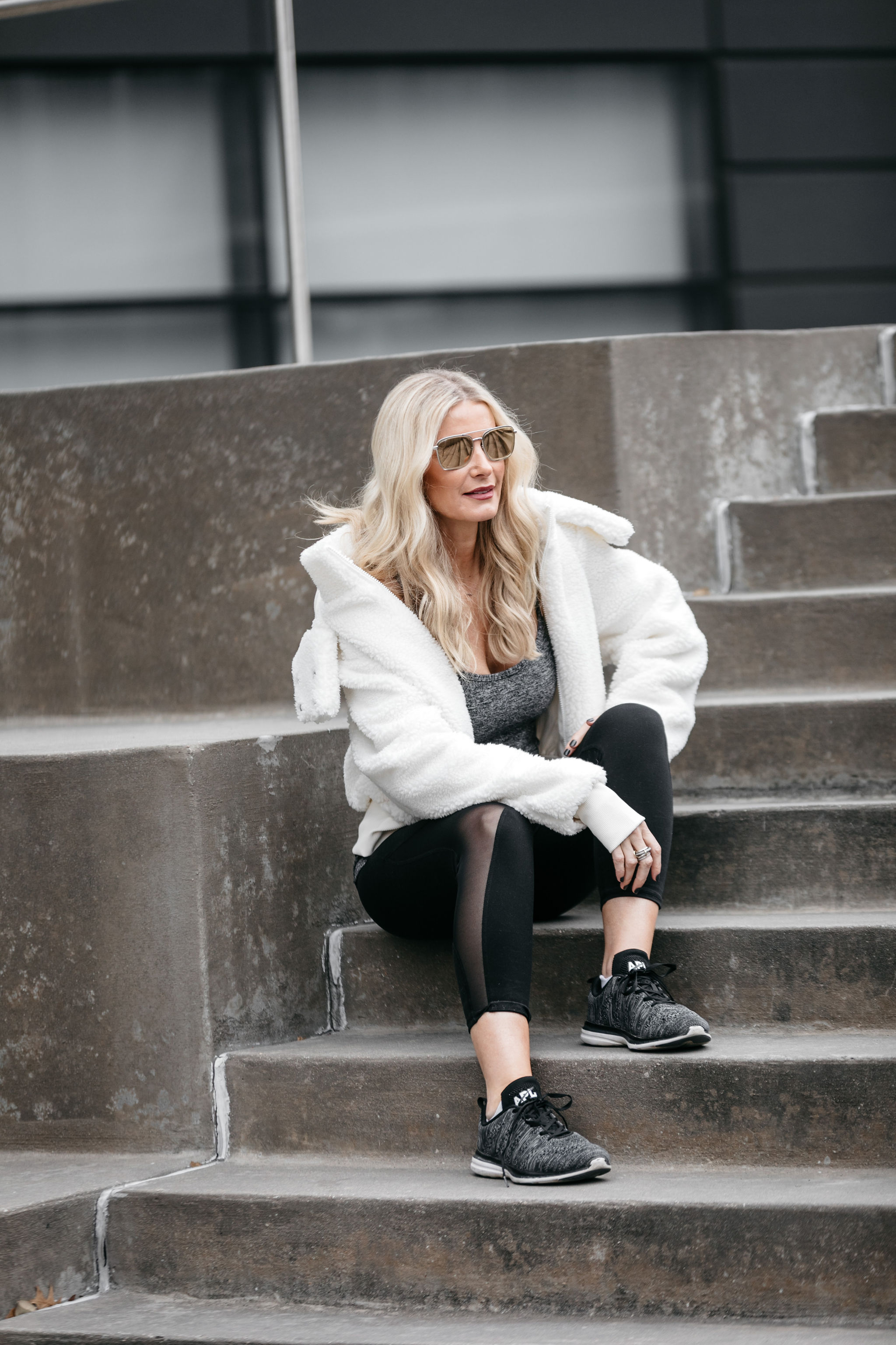 Dallas fitness blogger wearing teddy coat and black leggings