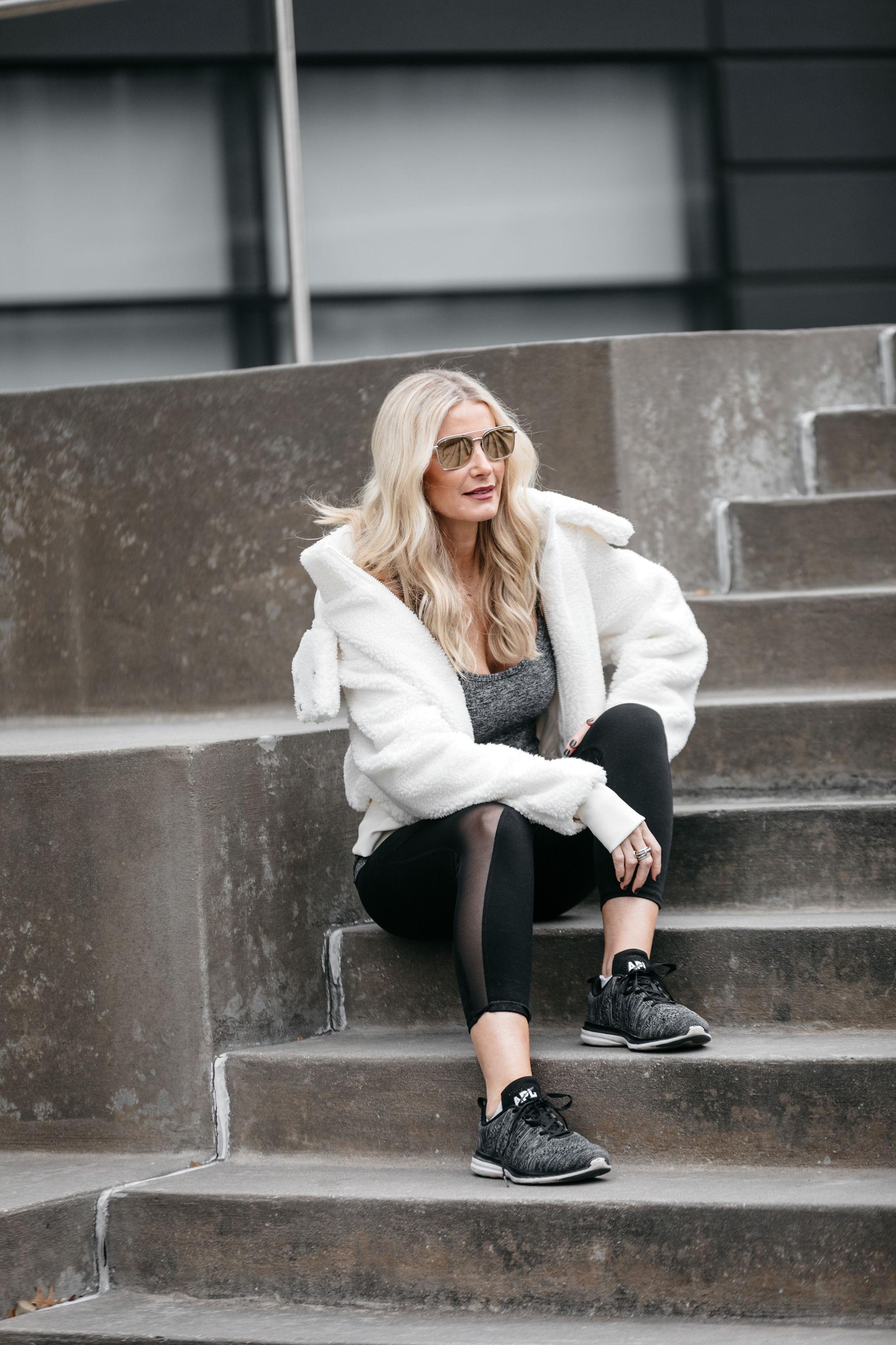 Dallas fitness blogger wearing teddy coat and black leggings