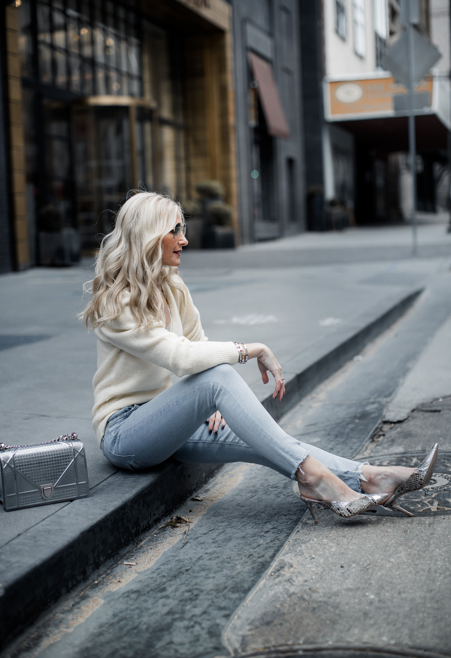 Dallas style blogger wearing Agolde jeans and snake print heels