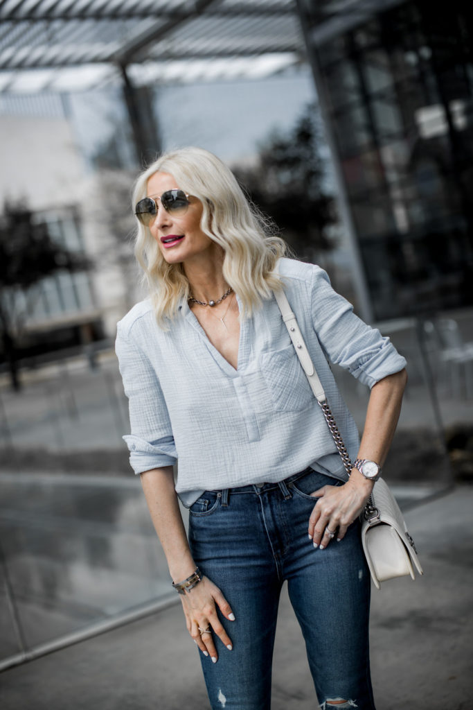 Dallas fashion blogger wearing blue top and blue denim jeans by Paige