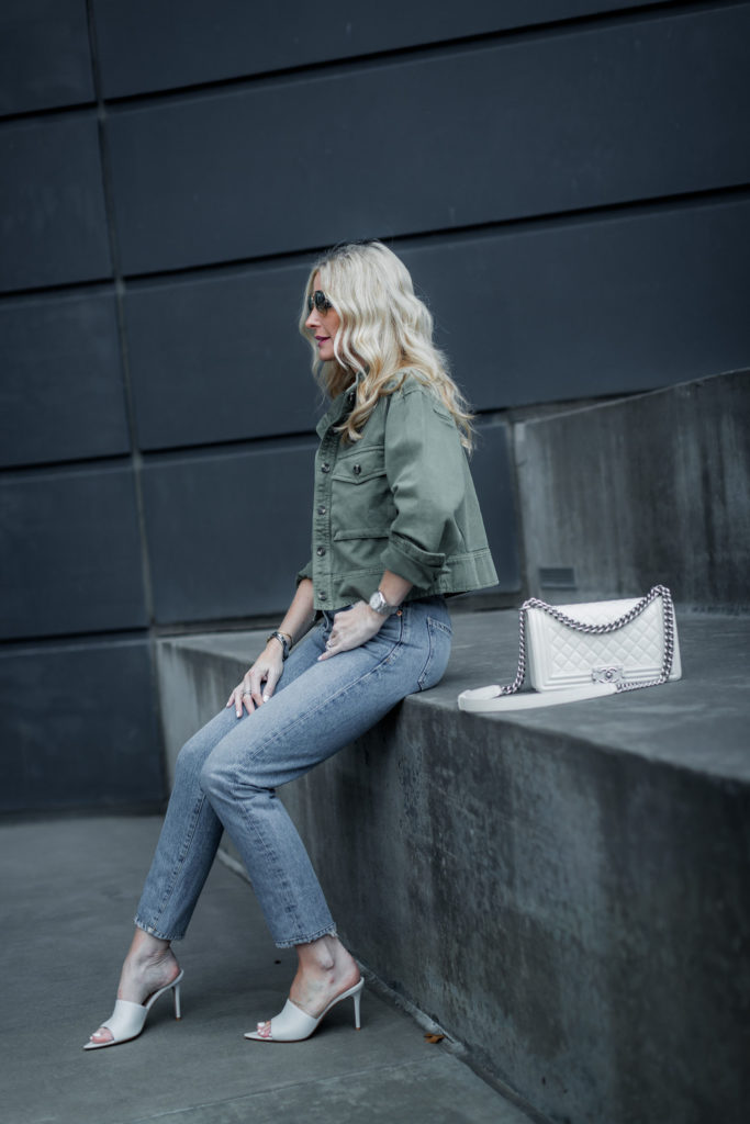 Dallas blogger wearing white Chanel Boy Bag and green military jacket