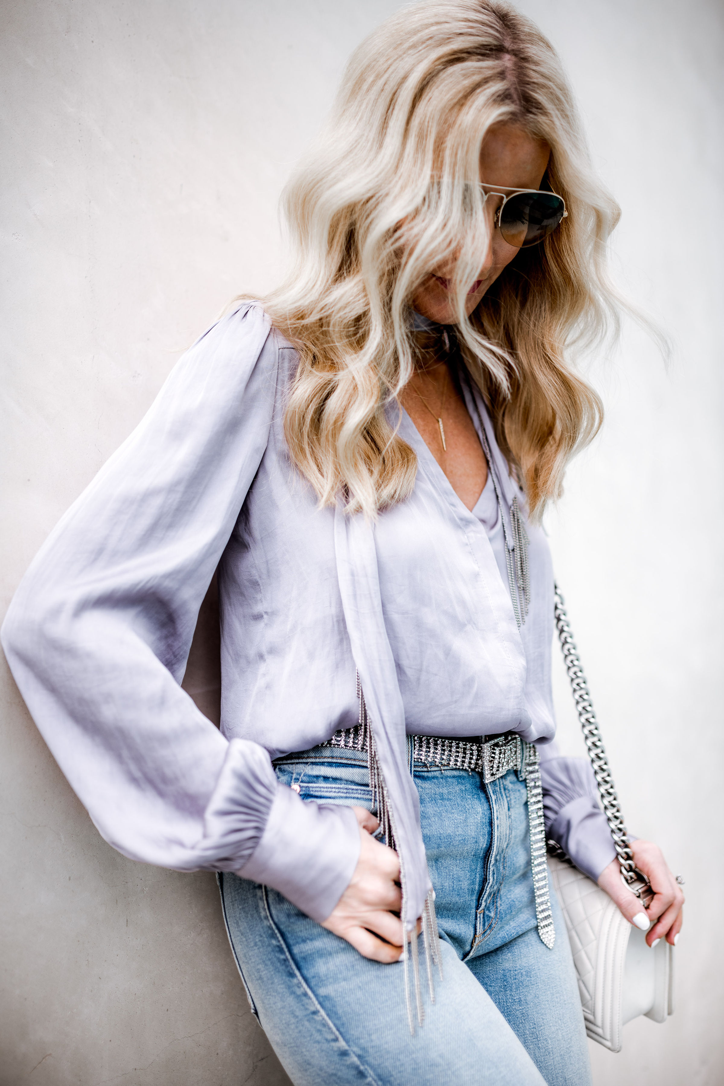 Dallas fashion blogger wearing silver belt and Mother jeans