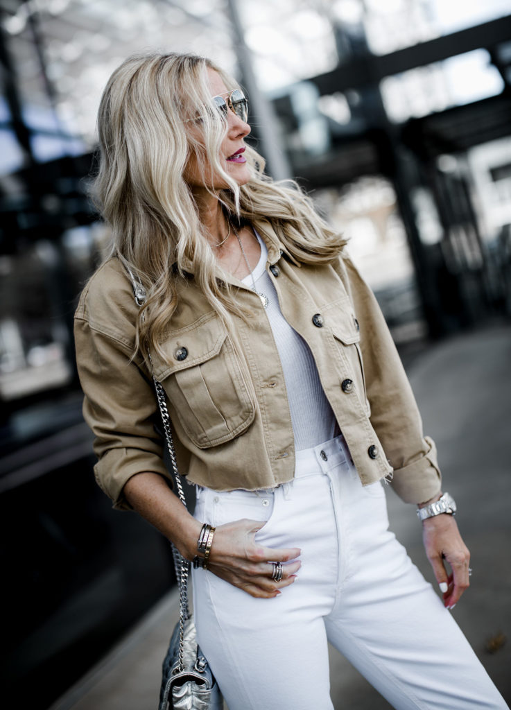 Dallas blogger wearing cropped jacket and Agolde white jeans