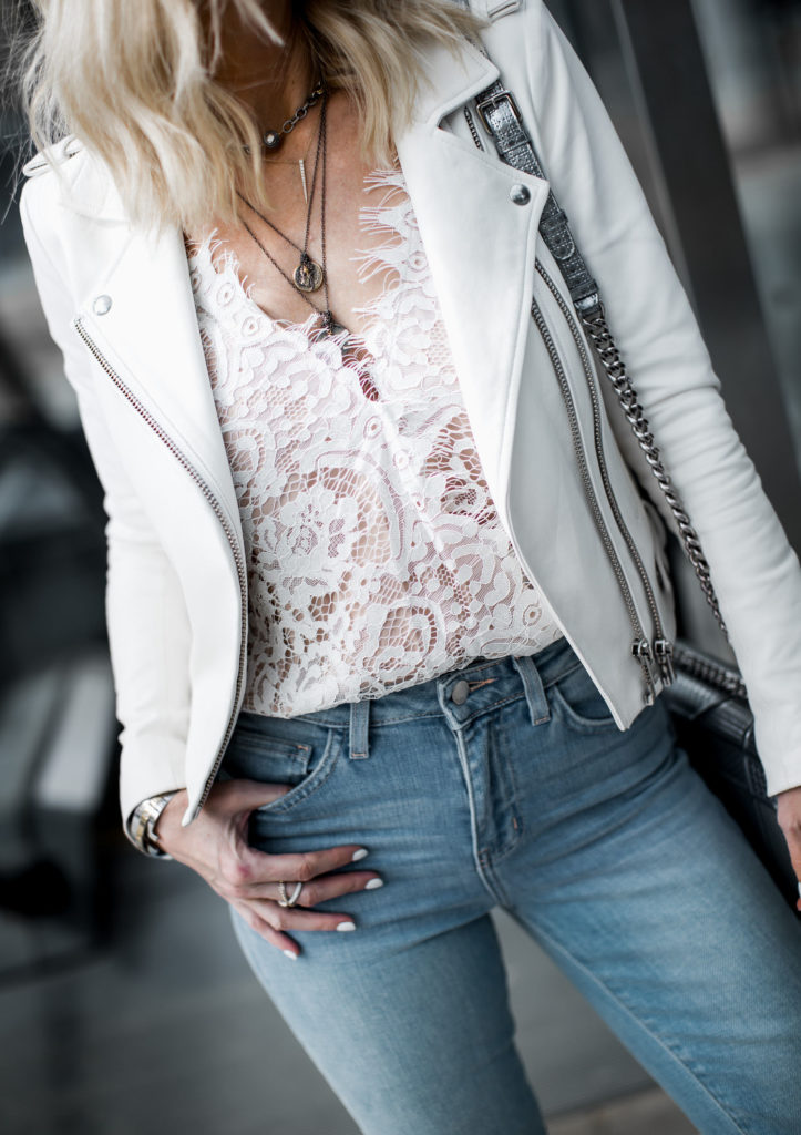 Dallas style blogger wearing lace top and Iro white leather jacket