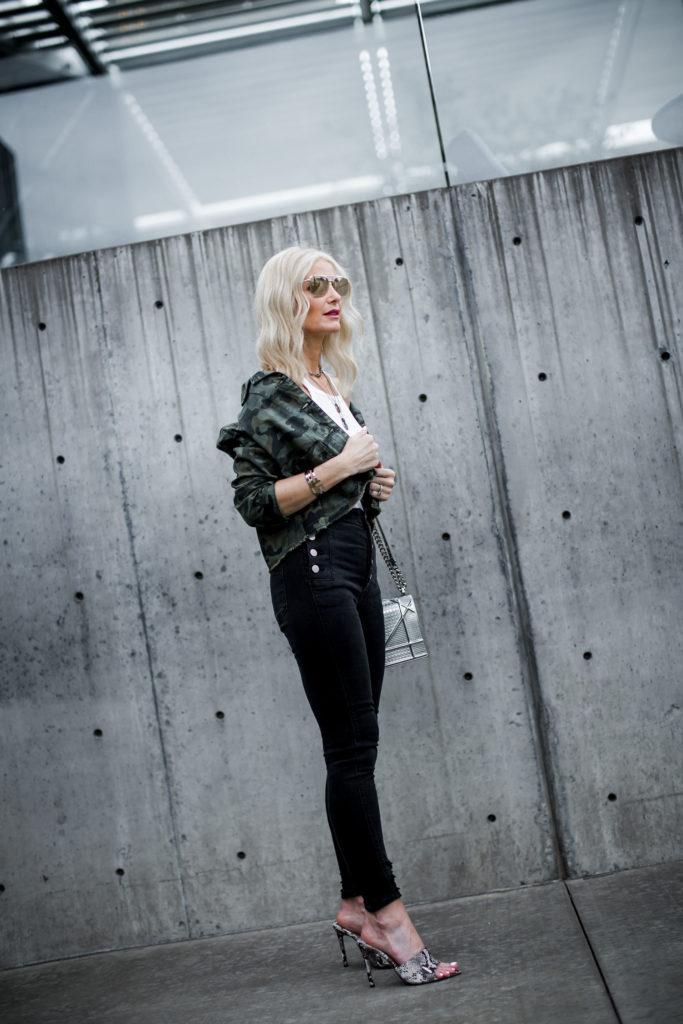 Dallas blogger wearing camo jacket, snake print heels, and J Brand Natasha jeans