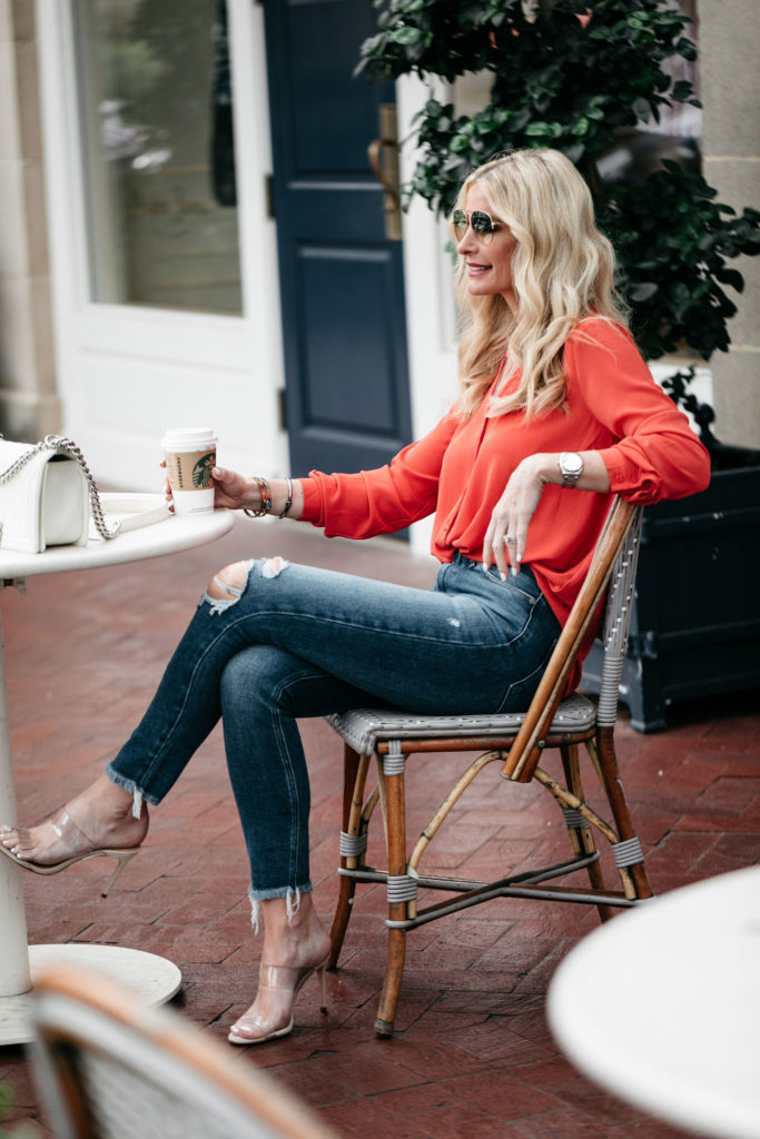 Best Spring Tops Under $50 on the blog & Dallas blogger wearing ripped jeans and coral top