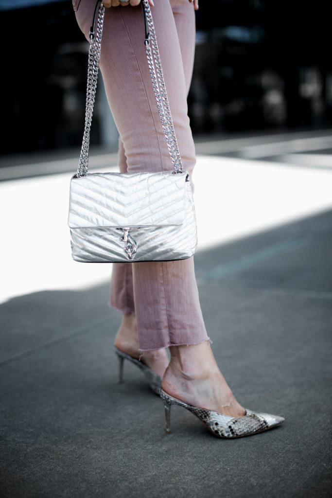 Rebecca Minkoff handbag, Gianvito Rossi snake print mules, and AG jeans