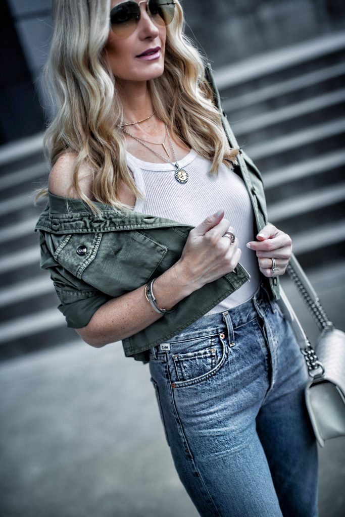 Dallas blogger wearing utility jacket and white tank