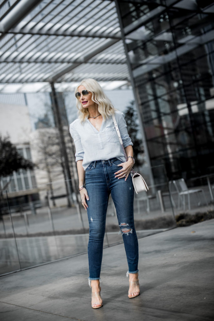 Dallas blogger wearing ripped jeans and nude heels