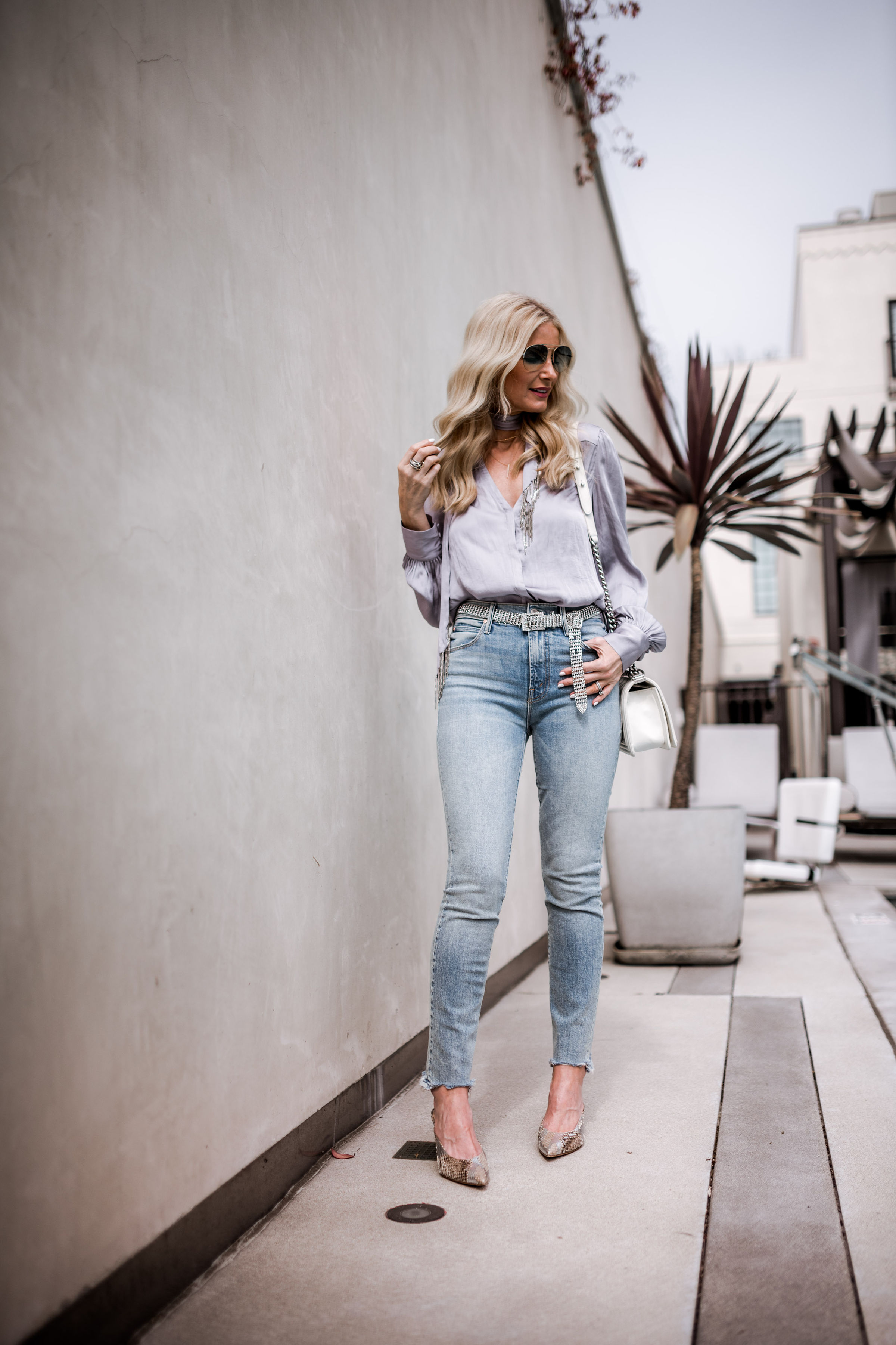 Dallas style blogger wearing Paige denim top and Mother jeans