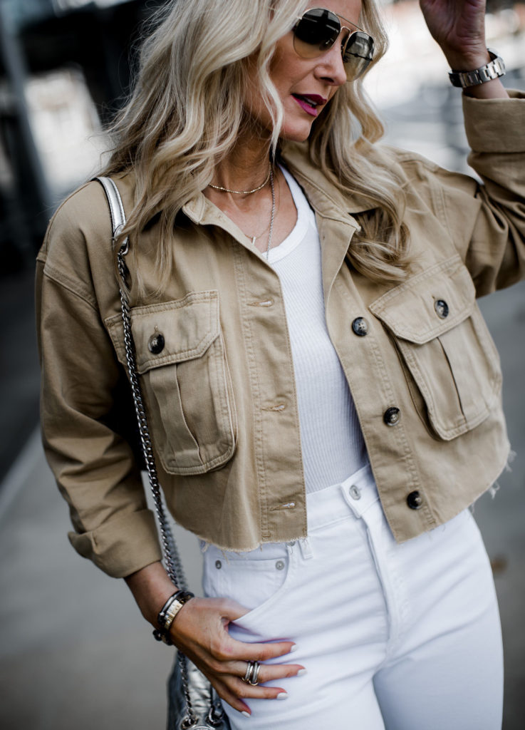Dallas blogger wearing cropped utility jacket and white jeans