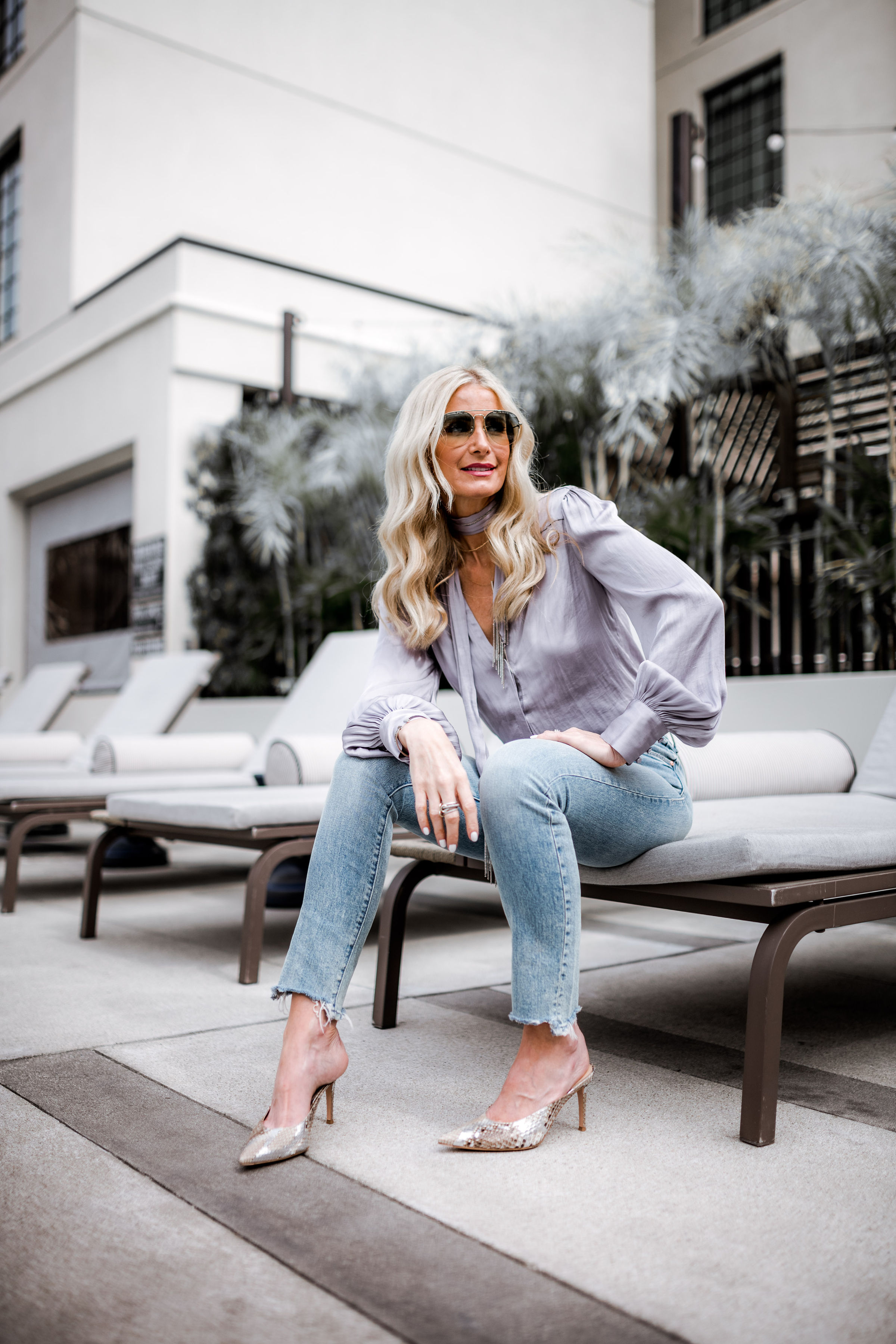 Dallas blogger wearing Paige satin top and Mother jeans