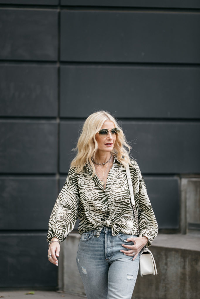 Dallas blogger wearing zebra print top and jeans