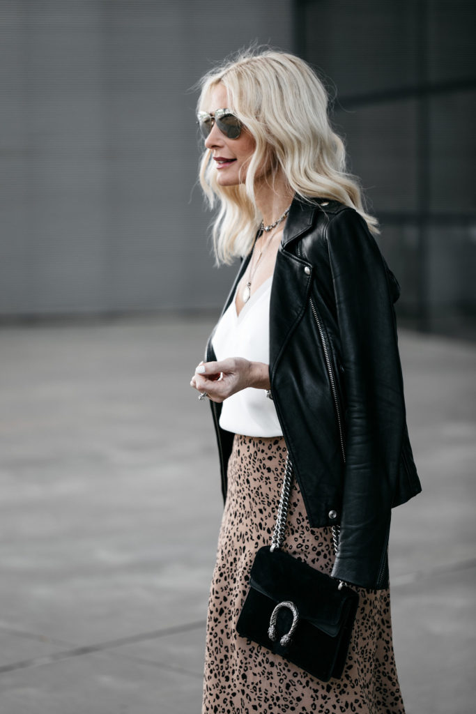 Dallas fashion blogger wearing a black leather jacket and a leopard midi skirt