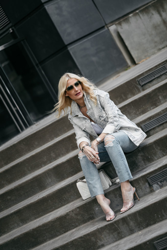 Dallas fashion influencer wearing snake print jacket and ripped jeans
