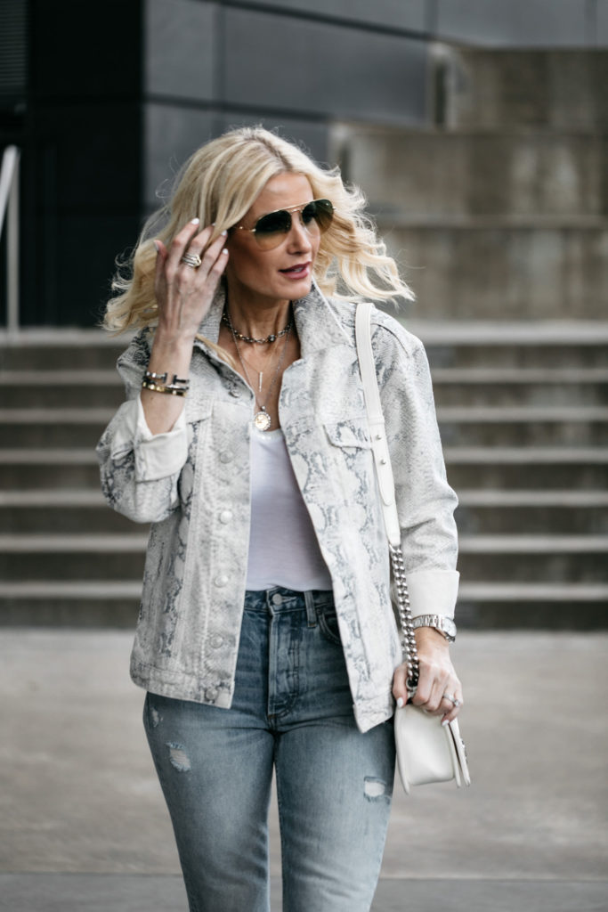 Dallas style blogger wearing Free People snake print jacket