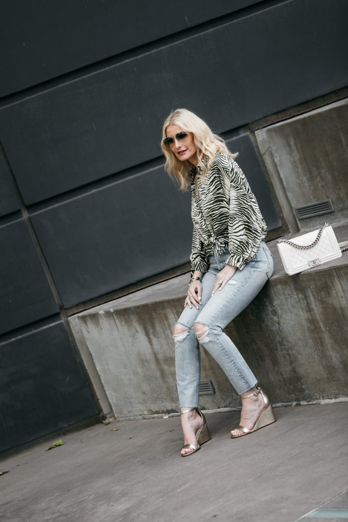 Dallas style blogger wearing Topshop blouse and ripped jeans
