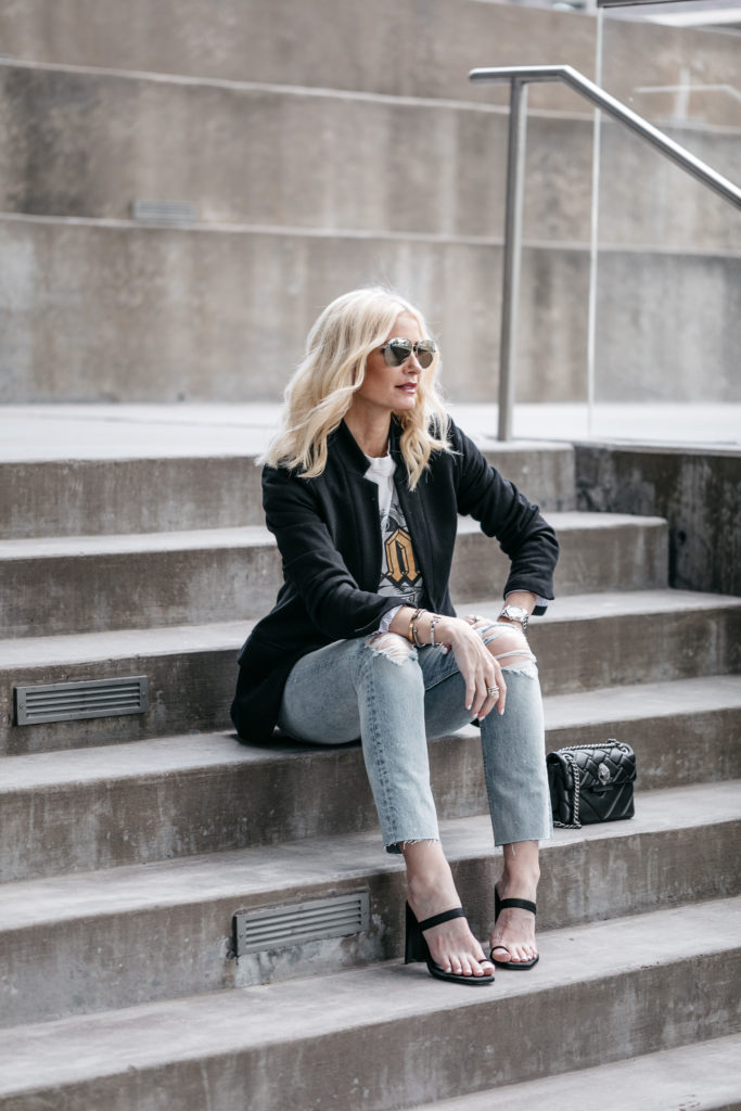 Dallas blogger wearing a black blazer, graphic tee and ripped jeans
