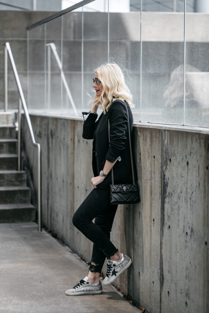 Dallas style influencer wearing Golden Goose sneakers