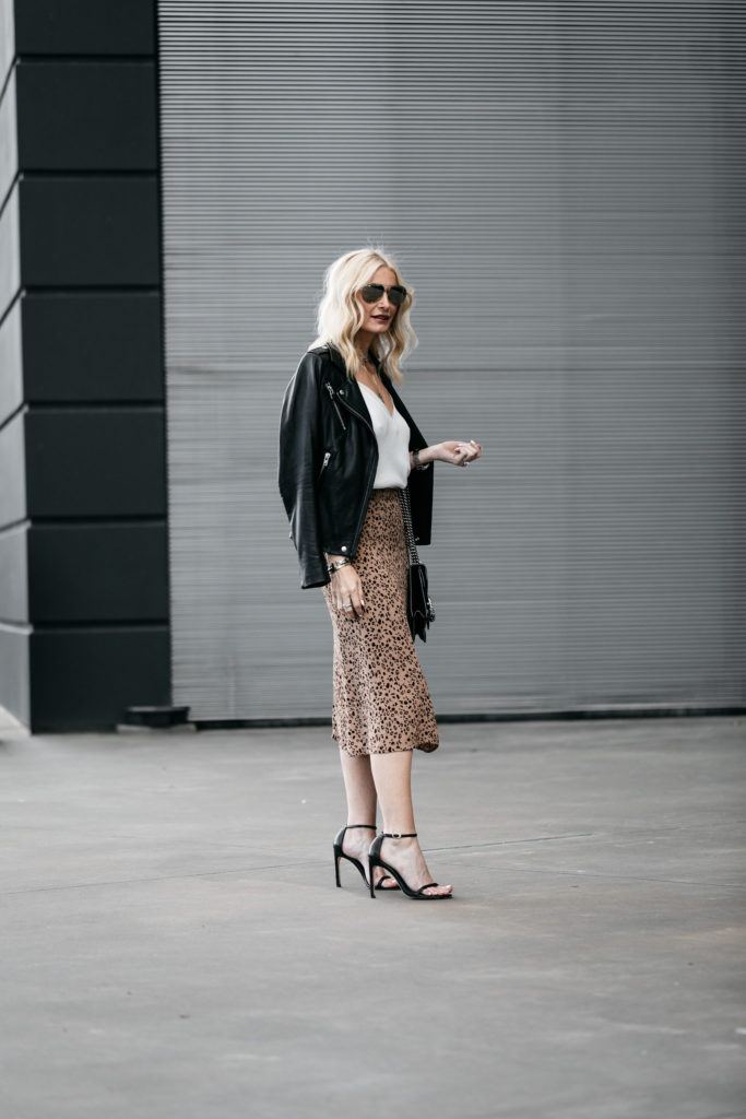 Dallas blogger wearing a leopard midi skirt and a black leather jacket