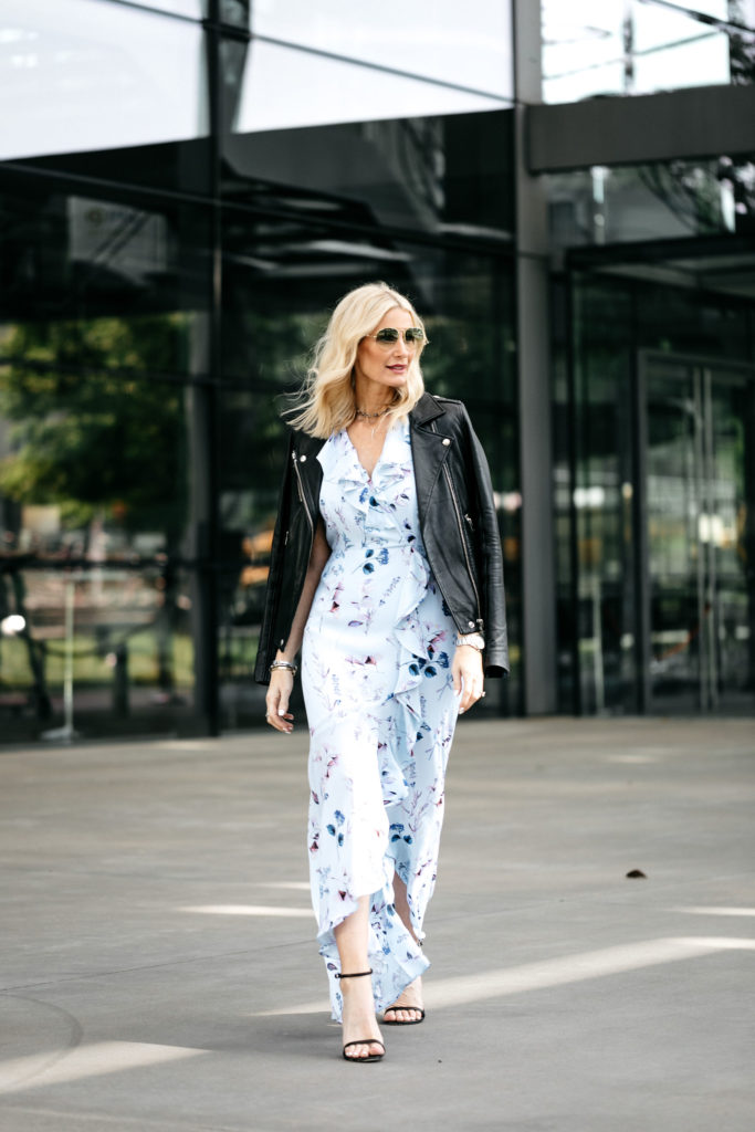 Dallas blogger wearing a floral maxi dress and black leather jacket